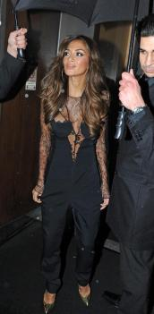 Nicole Scherzinger looks sexy in this lace jumpsuit from Anne Valérie Hash Fall Collection