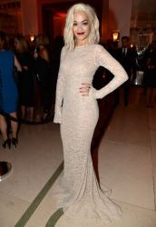 Rita Ora looks amazing at the Harper's Bazaar Women of the Year Awards. Wearing a form fitting nude lace number dying her hair and ultra platinum blonde and rocking her signature red lip.